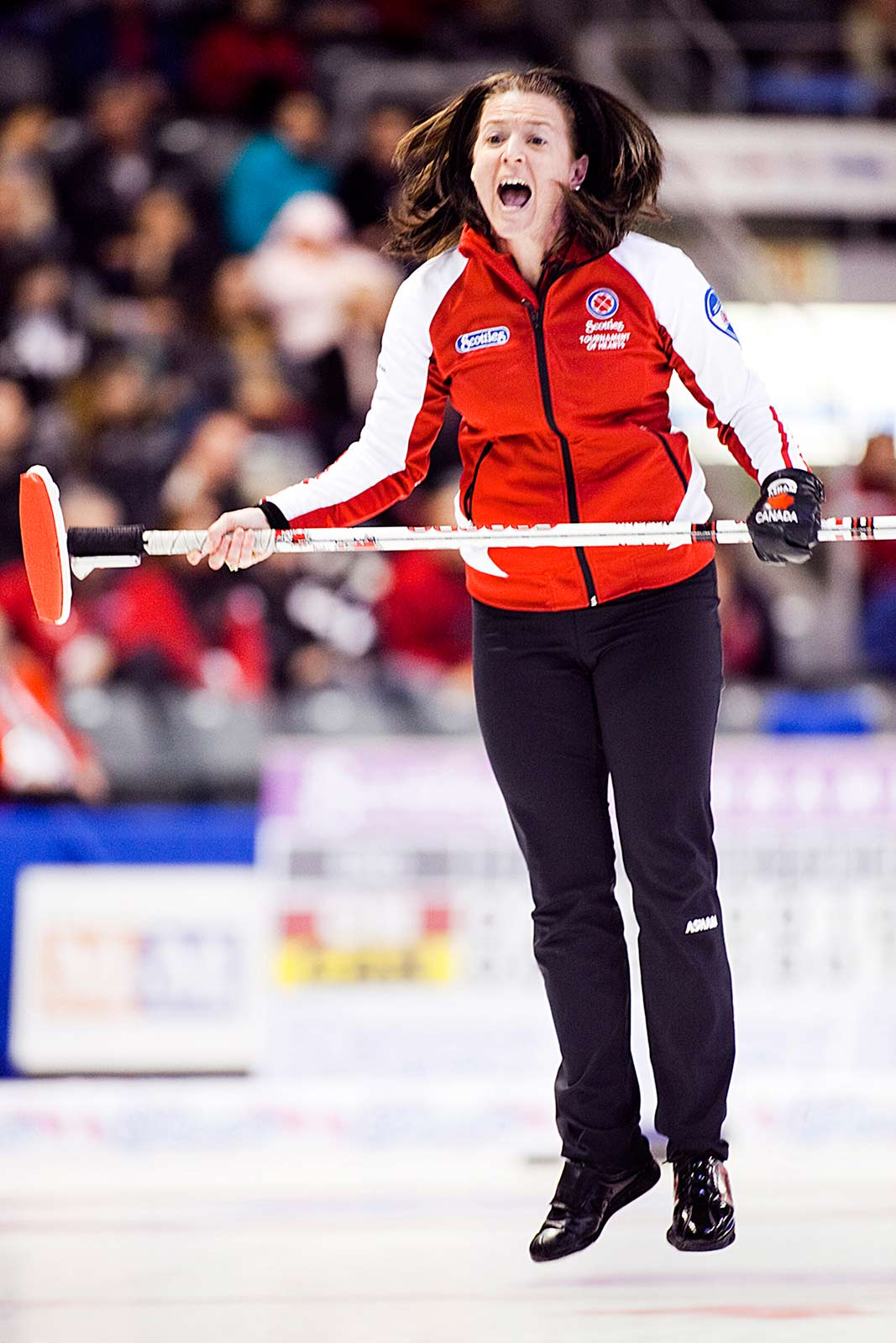 Heather Nedohin yells mid jump